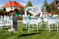 Arch and chairs at wedding ceremony. Outdoor Royalty Free Stock Image