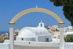 Arch upon a chapel in Oia, Santorini, Greece. Small arch upon a chapel and view on Oia village behind, Santorini, Greece Stock Photography