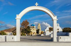 Arch, church and bell towers in Oia village, Santorini island, G Stock Photos