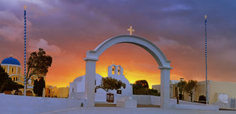 Arch, church and bell towers in Oia village, Santorini island, G. Reece on a sunrise with dramatic sky Stock Photo