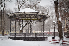 Arch in a city park covered with snow. Strong snow storm Stock Images