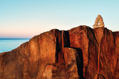 Arch on the cliff. Arch of pebbles on the top of the cliff Royalty Free Stock Photo