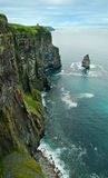 Arch cliff. Stone arch at the coast of Ireland on Mizen Head cliffs Stock Images