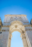 Arch and Clock Tower in Lisbon. White Arch in Lisbon Plaza with Clock Stock Photos