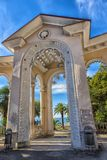 Arch of Colonnade in Gagra, Abkhazia, backlit against the sky,. Gagra, Abkhazia, 01.12.2017  Arch of Colonnade in Gagra, Abkhazia, backlit against the sky Royalty Free Stock Photos