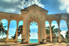 Arch of Colonnade in Gagra, Abkhazia, HDR. Arch of Colonnade in Gagra, Abkhazia, backlit against the sky, HDR processing Royalty Free Stock Photos