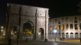 Arch and Colosseum. Triumphal Arch and Colosseum in Rome by night stock video