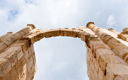 Arch and column in antique city of Gerasa Jerash. In Jordan Stock Photography