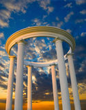 Arch with columns, arranged in a circle. At sunset Stock Images