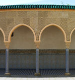 Arch and columns in the Oriental style. Architectural details in Arabic style Royalty Free Stock Image