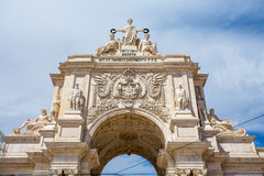 Arch at commerce square at Lisbon, Portugal. On a cloudy day Stock Photo