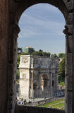 Arch of Constantine. The Arch of Constantine framed by an arch from the Coliseum in Rome, Italy Royalty Free Stock Photos