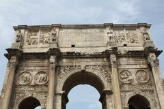 The Arch of Constantine. Is a triumphal arch in Rome, situated between the Colosseum and the Palatine Hill Stock Photos