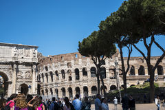 The Arch of Constantine and close to it the Colisseum in Rome Italy. The Colosseum was the Flavian Amphitheatre built by Vespasian in what was the lake of Nero Royalty Free Stock Photo