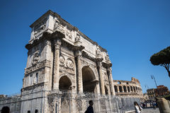 The Arch of Constantine and close to it the Colisseum in Rome Italy. The Colosseum was the Flavian Amphitheatre built by Vespasian in what was the lake of Nero Royalty Free Stock Image