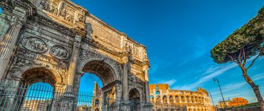 Arch of Constantine with Coliseum. On the background Stock Photography
