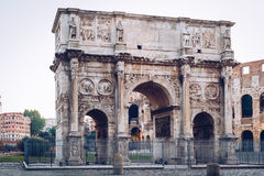 Arch of Constantine and coliseum in background at Rome, Italy Stock Images