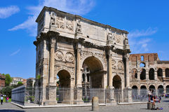 Arch of Constantine and Coliseum in Rome, Italy. ROME, ITALY - APRIL 17: the Arch of Constantine and the Coliseum on April 17, 2013 in Rome, Italy. The Coliseum Royalty Free Stock Image