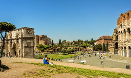 Arch of Constantine and Coliseum in Rome, Italy. ROME, ITALY - APRIL 17: The Arch of Constantine and the Coliseum on April 17, 2013 in Rome, Italy. The Coliseum Stock Image