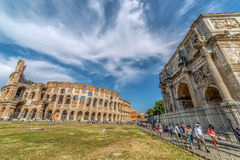 Arch of Constantine and Coliseum in Rome, Italy. ROME, ITALY - MAI 30, 2017: View of the arch of Constantine and the Coliseum in Rome, Italy with a lot tourists Royalty Free Stock Photography