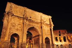Arch of Constantine and Coliseum in Rome, Italy. View of the Arch of Constantine and the Coliseum at night in Rome, Italy Royalty Free Stock Photos