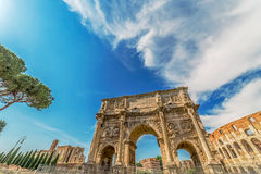 Arch of Constantine and Coliseum. View of the arch of Constantine, near the Coliseum in Rome, Italy. Sky with clouds in background Stock Image