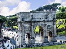 The Arch of Constantine by the Colosseum in the city of Rome Italy. The Colosseum was the Flavian Amphitheatre built by Vespasian in what was the lake of Nero' Stock Photo