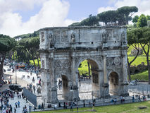The Arch of Constantine by the Colosseum in the city of Rome Italy. The Colosseum was the Flavian Amphitheatre built by Vespasian in what was the lake of Nero' Royalty Free Stock Photo