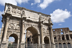 Arch of Constantine and Colosseum or Coliseum. In background at Rome, Italy Stock Image