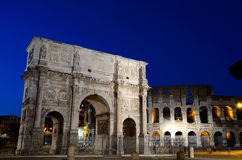 Arch of Constantine and Colosseum at night. The Arch of Constantine is a triumphal arch, erected c. 315 CE to commemorate the triumph of Constantine I after his Royalty Free Stock Photography