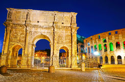 Arch of Constantine and Colosseum at night. View of the Arch of Constantine and Colosseum at night in Rome, Italy Stock Photo