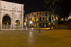 The Arch of Constantine and Colosseum, Rome. The Arch of Constantine (Italian: Arco di Costantino) is a triumphal arch in Rome, situated between the Colosseum Stock Photo