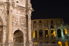 The Arch of Constantine and Colosseum, Rome. The Arch of Constantine (Italian: Arco di Costantino) is a triumphal arch in Rome, situated between the Colosseum Royalty Free Stock Image