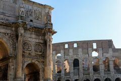Arch of Constantine and Colosseum in Rome, Italy. Concept of ancient landmarks and last minute cheap tours to Europe Royalty Free Stock Image
