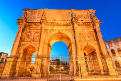 The Arch of Constantine and  the Colosseum in Rome, Italy. The Arch of Constantine next to the Colosseum in Rome, Italy Royalty Free Stock Photography