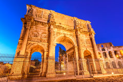 The Arch of Constantine and  the Colosseum in Rome, Italy. The Arch of Constantine next to the Colosseum in Rome, Italy Stock Photography