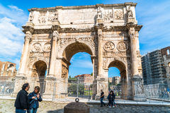 Arch of Constantine at Colosseum. Rome, Italy - October 18, 2015 : View of the Arch  of Constantine and tourists near the Colosseum on October 18, 2015 Stock Photos