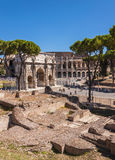 Arch of Constantine and Colosseum. Rome, Italy. Arch of Constantine and Colosseum seen from the Imperial Fora Royalty Free Stock Photos