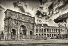 Arch of Constantine and The Colosseum, Rome. Arch of Constantine and The Colosseum at the Roman Forum in Rome, Italy Royalty Free Stock Images