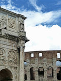 Arch of Constantine and Colosseum in Rome. Constantine's Arch in juxtaposition to the walls of the nearby Colosseum Royalty Free Stock Photos