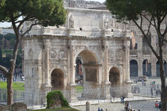 Arch of Constantine. The Arch of Constantine the Great stands in front of the Colosseum in Rome. This photo is taken from the Palatino. Photo taken April 2015 Royalty Free Stock Photo