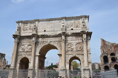 Arch of Constantine. The Arch of Constantine the Great stands in front of the Colosseum in Rome. This photo is taken from the Palatino. Photo taken April 2015 Stock Photos
