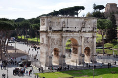Arch of Constantine near the Colosseum in Rome, Italy. ROME, ITALY - MARCH 16, 2016: Tourist visiting the triumphal Arch of Constantine near the Colosseum in Stock Image