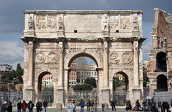 Arch of Constantine near the Colosseum in Rome, Italy. ROME, ITALY - MARCH 16, 2016: Tourist visiting the triumphal Arch of Constantine near the Colosseum in Stock Images