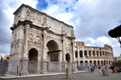 Arch of Constantine near the Colosseum in Rome, Italy. ROME, ITALY - MARCH 16, 2016: Tourist visiting the triumphal Arch of Constantine near the Colosseum in Royalty Free Stock Image