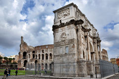 Arch of Constantine near the Colosseum in Rome, Italy. ROME, ITALY - MARCH 16, 2016: Tourist visiting the triumphal Arch of Constantine near the Colosseum in Stock Photo