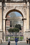 Arch of Constantine near the Colosseum in Rome, Italy. ROME, ITALY - MARCH 16, 2016: Tourist visiting the triumphal Arch of Constantine near the Colosseum in Stock Photography