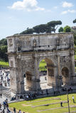 The Arch of Constantine near the Colosseum in Rome Italy. The Colosseum was the Flavian Amphitheatre built by Vespasian in what was the lake of Nero's Golden Royalty Free Stock Photo