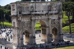 The Arch of Constantine near the Colosseum in Rome Italy. The Colosseum was the Flavian Amphitheatre built by Vespasian in what was the lake of Nero's Golden Stock Photo