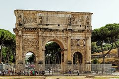 The Arch of Constantine nearby the Colosseum. Erected by the Roman Senate to commemorate Constantine I`s victory over Maxentius at the Battle of Milvian Bridge Stock Images